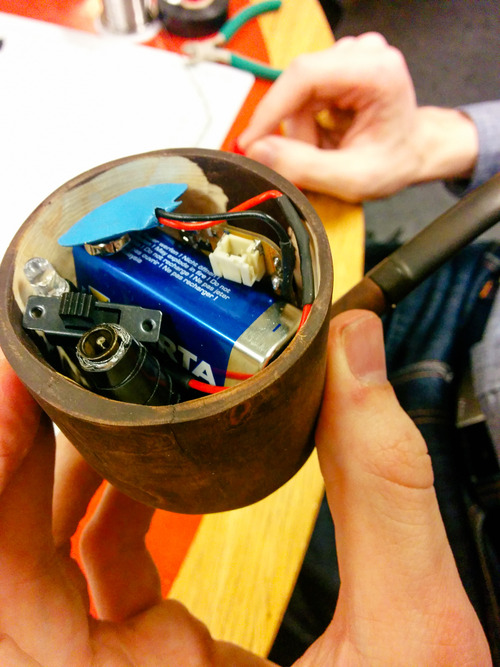 Inside the Peripipe: batteries, wires, an Arduino, LEDs and more.